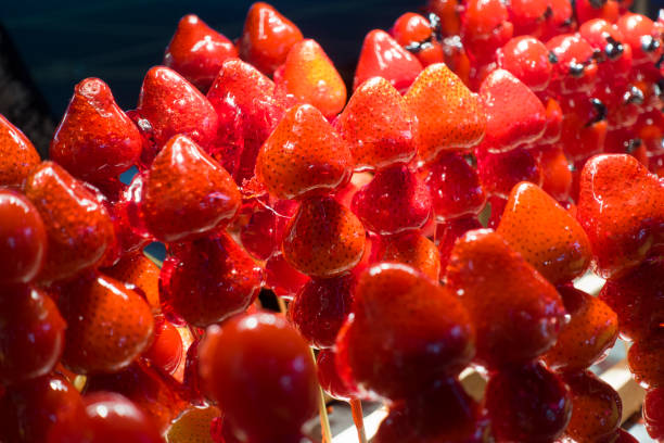 Strawberry sweet cover with clear sugar selling at street market in Taipei, Taiwan. stock photo