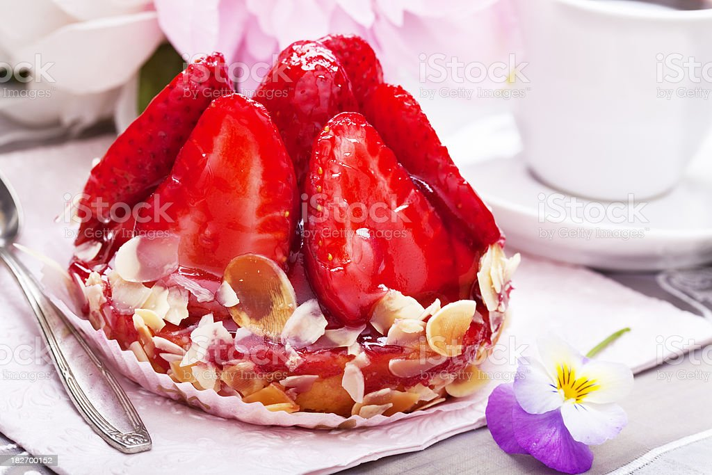 strawberry tartlet and flower decoration royalty-free stock photo
