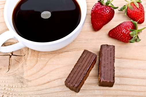Strawberry With A Cup Of Coffee And Chocolate On Wood Stock Photo - Download Image Now