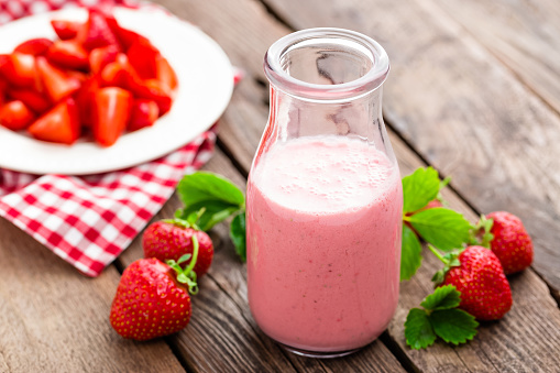 Strawberry yogurt with fresh berries, delicious drink, cocktail