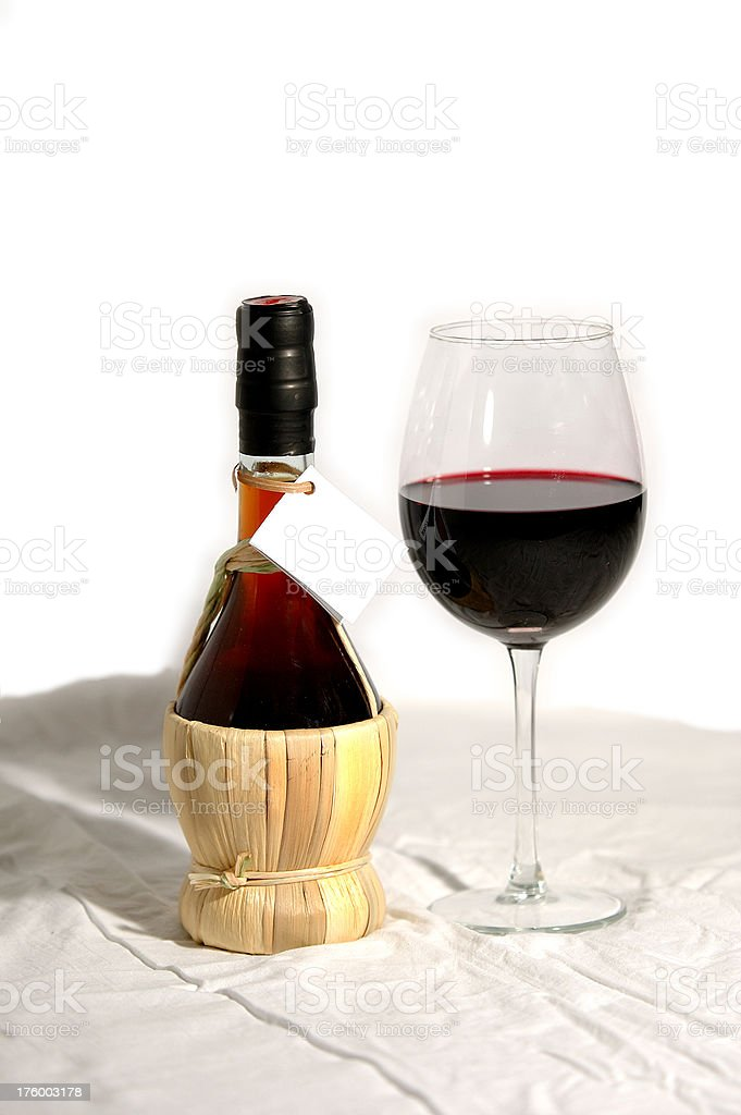Straw-wrapped Glass Wine Flask royalty-free stock photo