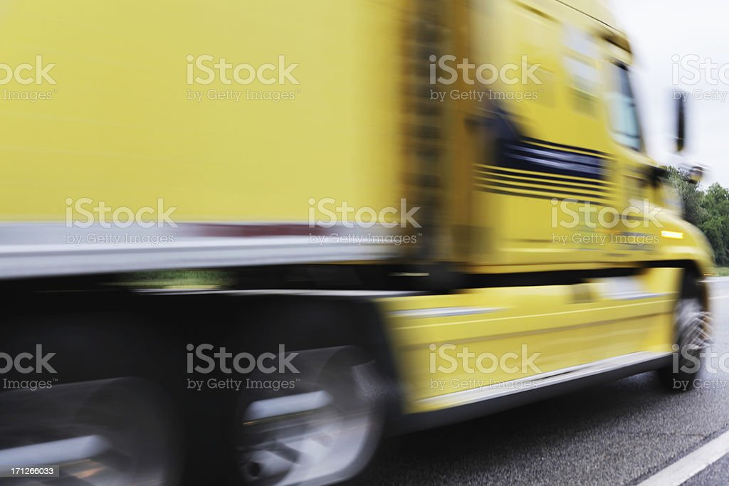 Streaking Yellow Trailer Truck royalty-free stock photo