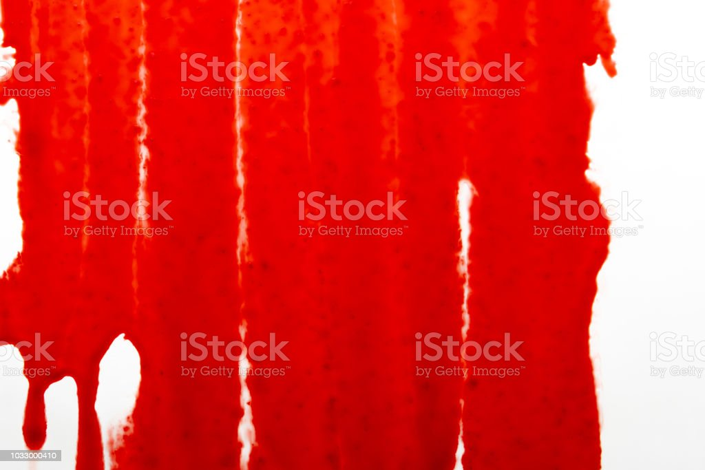 Streaks of blood pouring on a white surface stock photo