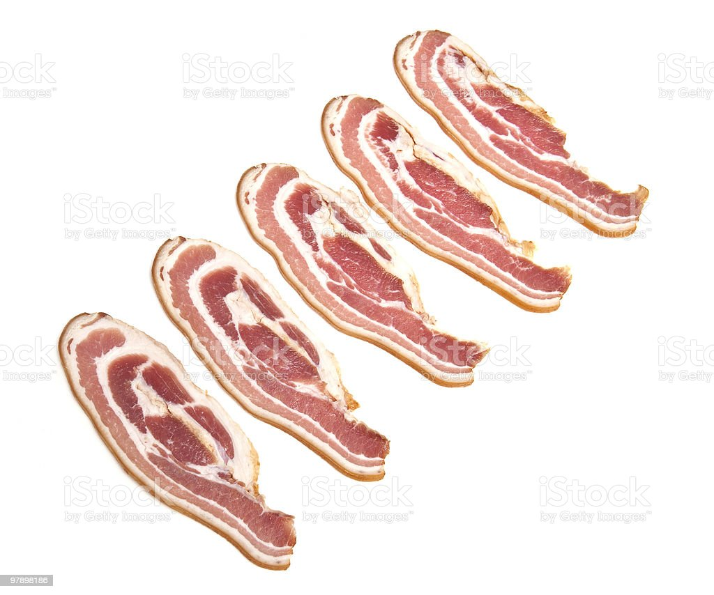 Streaky bacon slices on a white studio background. royalty-free stock photo