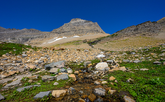 Stream Flows Off Mountain Side Stock Photo - Download Image Now