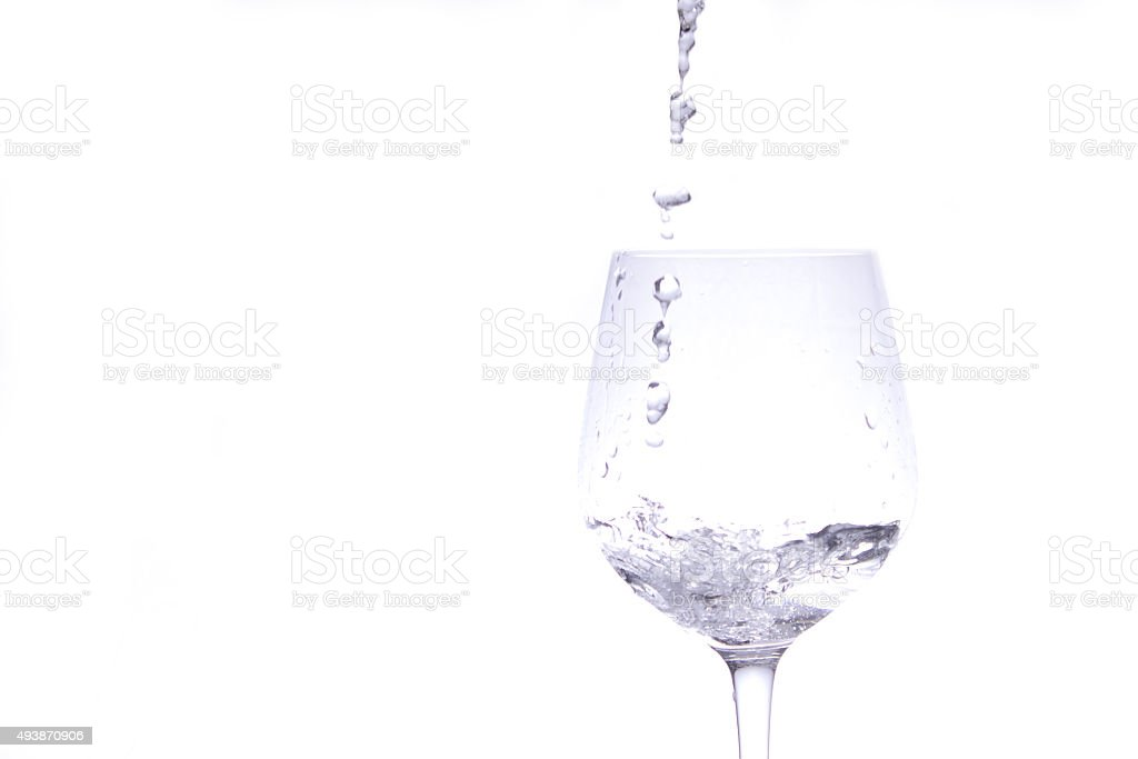 Stream Of Water Pouring Into Wineglass Stock Photo