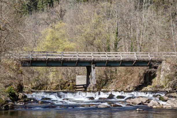 Stream under the bridge. stock photo
