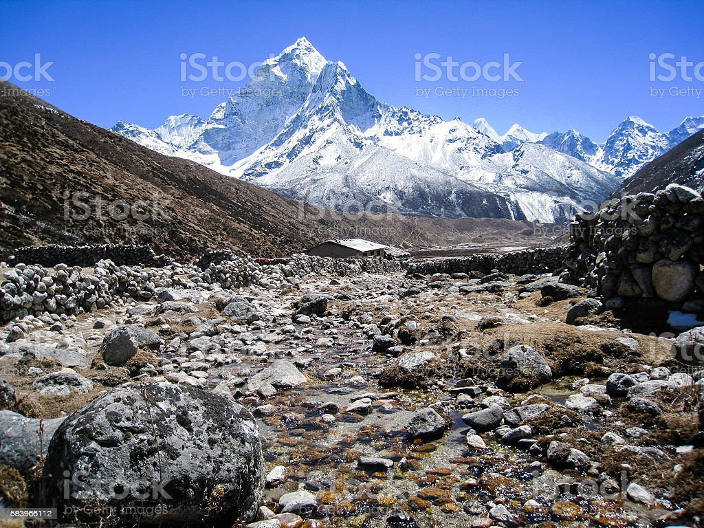 Stream with snow mountains in Everest Region stock photo