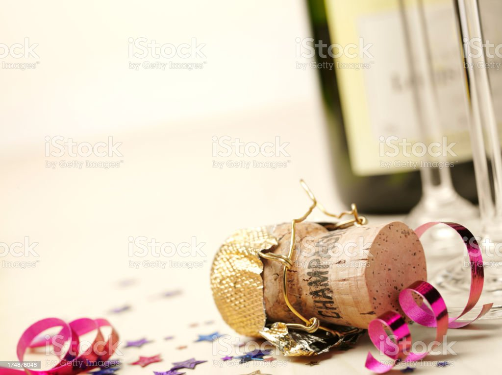 Streamers and Confetti with a Champagne Cork royalty-free stock photo