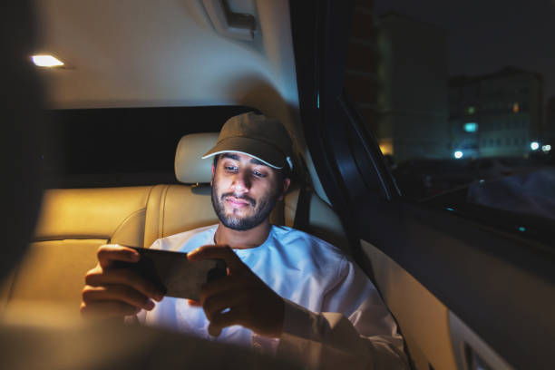 Streaming football on a smart phone while riding a car stock photo