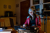 istock DJ streaming from home at night 1252124500