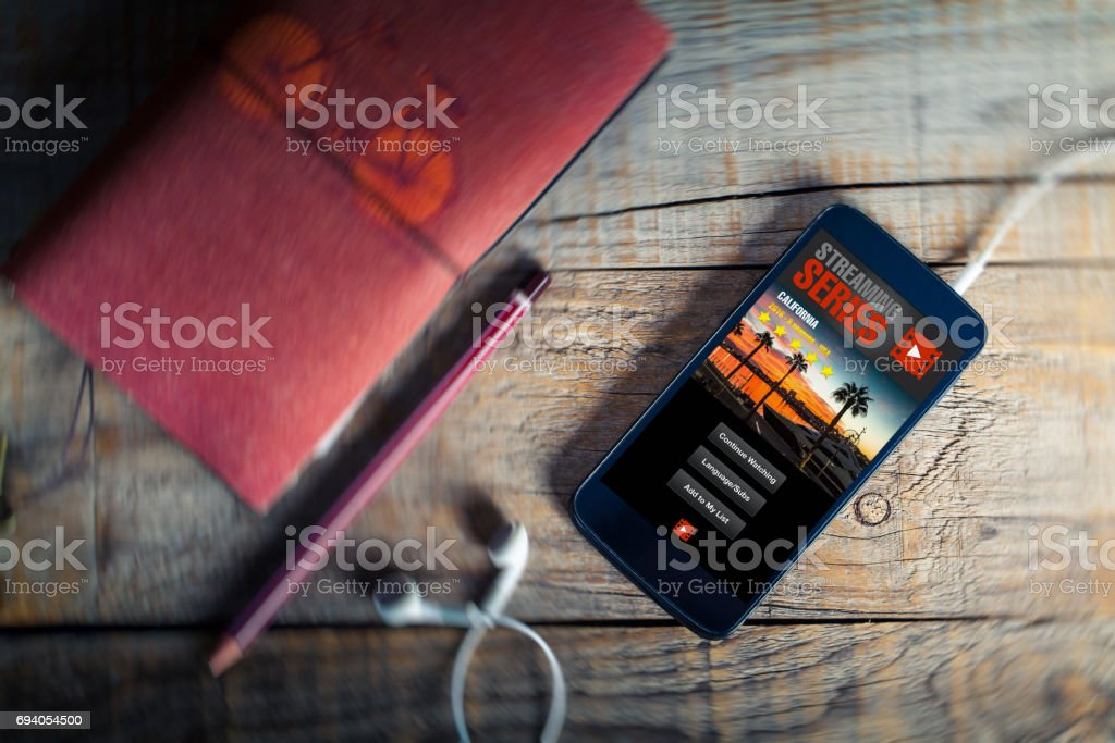 Streaming series app service in a mobile phone screen. stock photo