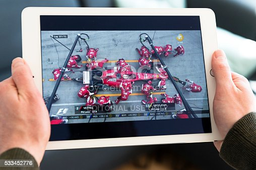 Copenhagen, Denmark - April 22, 2016: Streaming video on an Apple iPad of a pitstop performed by the Ferrari F1 team during a race. Camera angle from above shows the mechanics change tires on the race car. Sebastian Vettel from Germany is behind the wheel of the F1 racer from Ferrari.