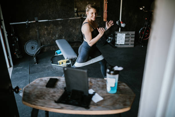 Streaming Workout Instructor in Home Gym