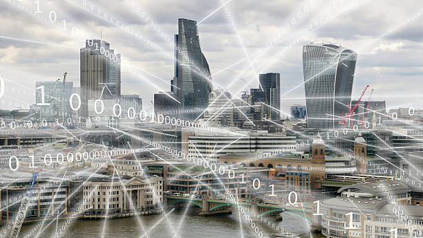 Streams of binary data flying round London. stock photo