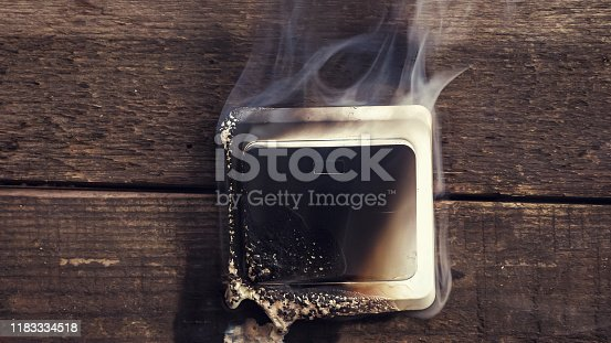 1015605026 istock photo Streams of black smoke come from the switch. 1183334518