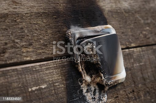 1015605026 istock photo Streams of black smoke come from the switch. 1183334531