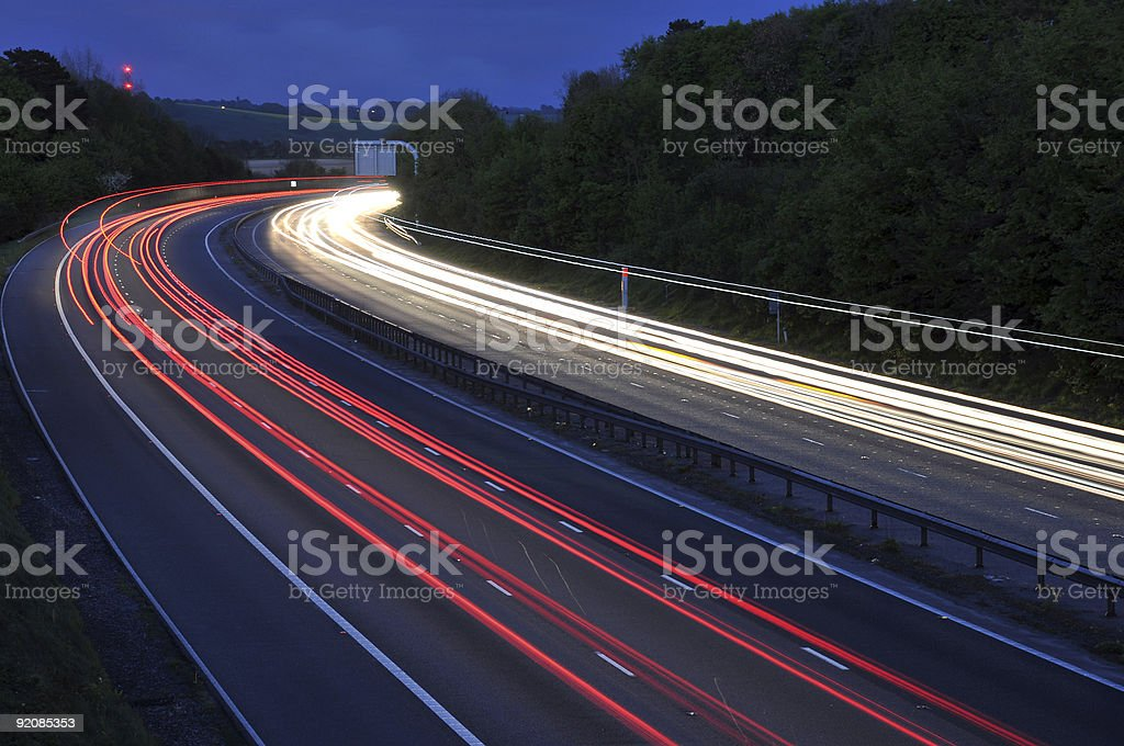 Streams of car lights at night on the interstate  stock photo