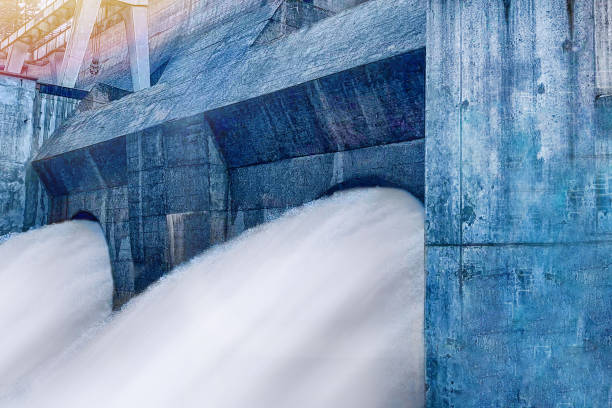 streams of water from turbines of a hydroelectric power station. - diga foto e immagini stock