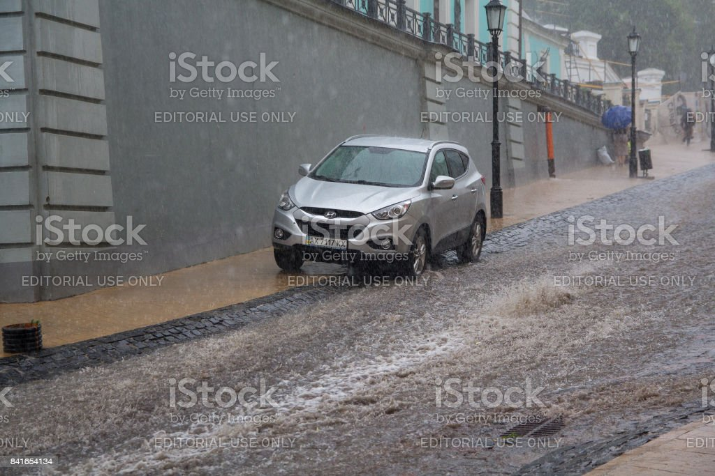 Streams of water in heavy rain on Andreevsky Descent - the historical part of the city stock photo