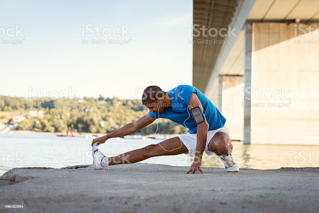 Streching tired muscles stock photo