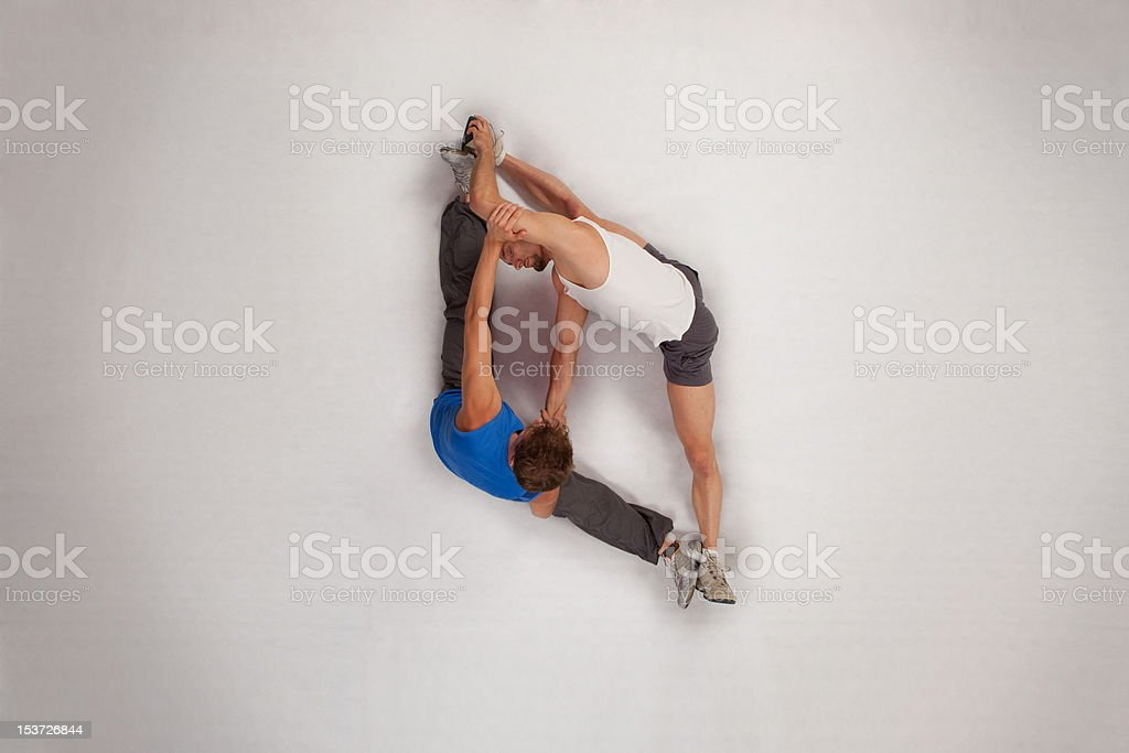 Streching with personal trainer royalty-free stock photo