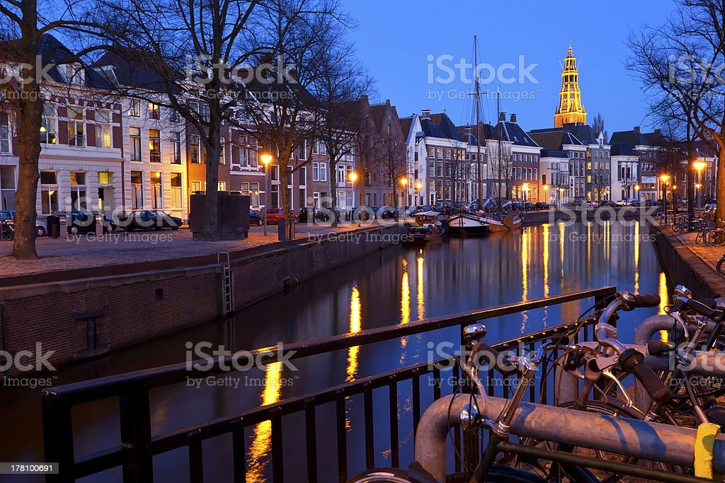 street along canal at night in Groningen stock photo