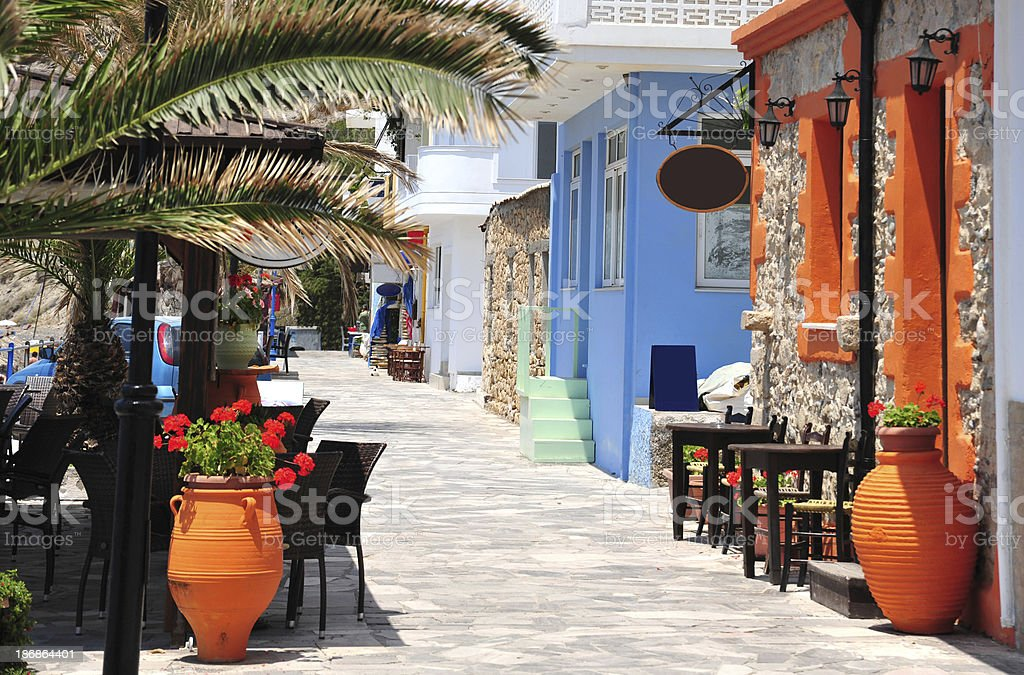 Street along the beach at Mirtos in southern Crete, Greece stock photo