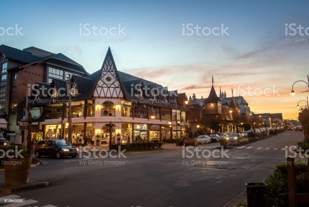 Street and architecture of Gramado city at sunset - Gramado, Rio Grande do Sul, Brazil stock photo