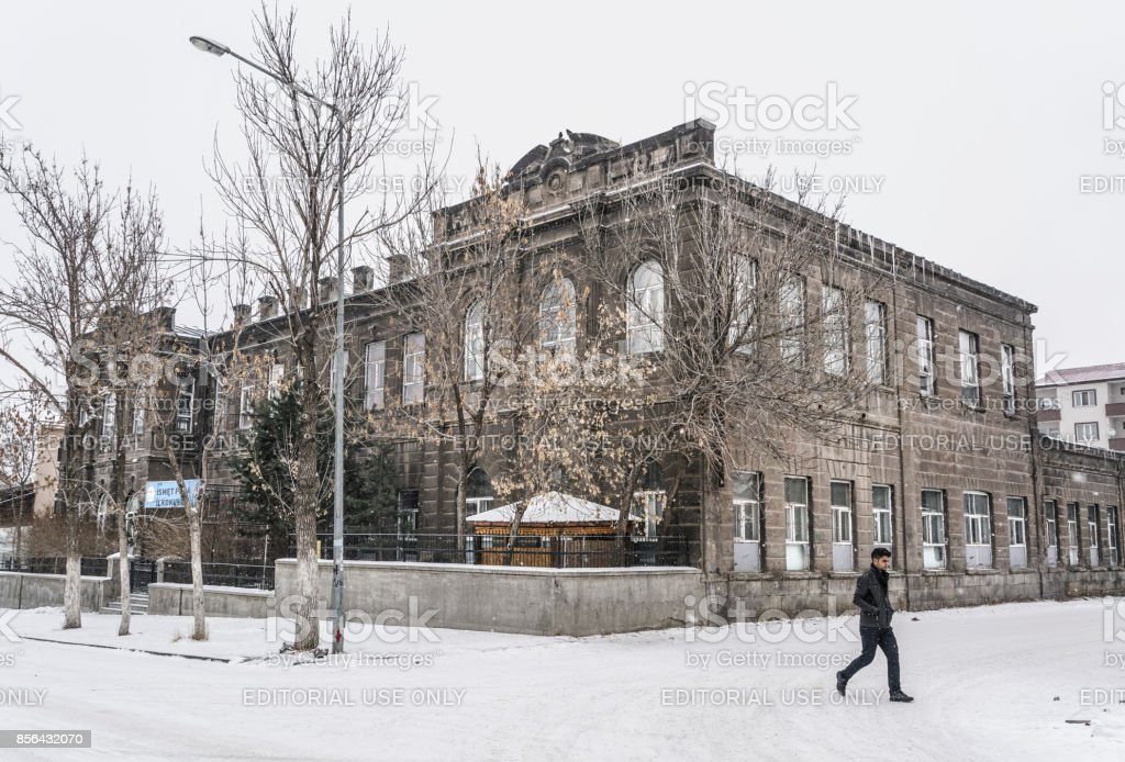 Street and buildings under snow in Kars city of Turkey during winter. stock photo