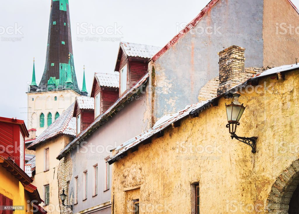 Street and St Olaf Church in Old town of Tallinn stock photo