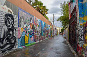 Photo of San Francisco Mission District with Street Art and Murals painted on walls.