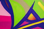 Multi colored street art graffiti on the school wall.