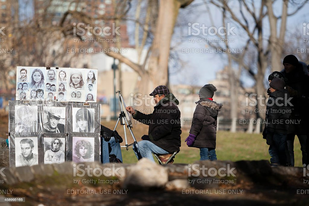Street artist in Central Park royalty-free stock photo