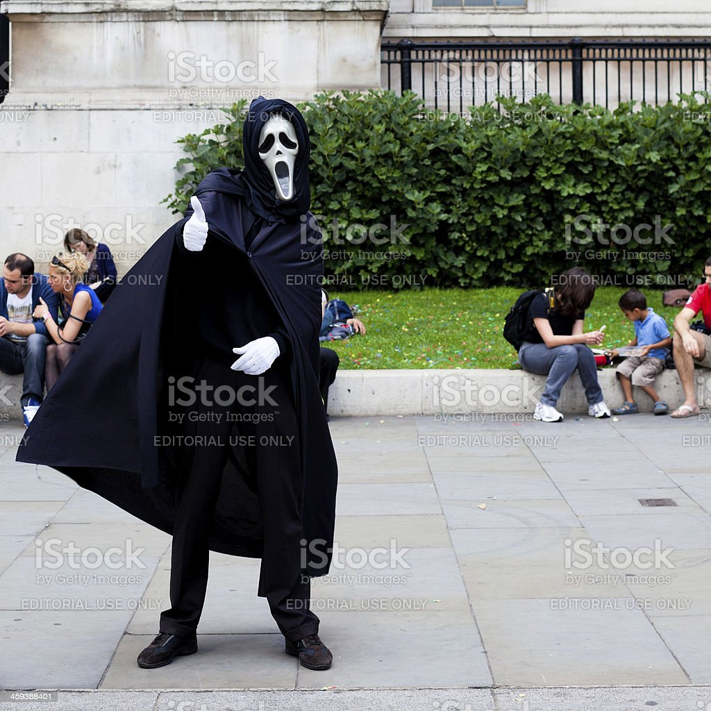 Street Artist in Trafalgar Square with 'the scream' Mask royalty-free stock photo