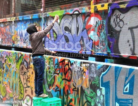 488380038 istock photo Street artist Melbourne graffiti 458870757
