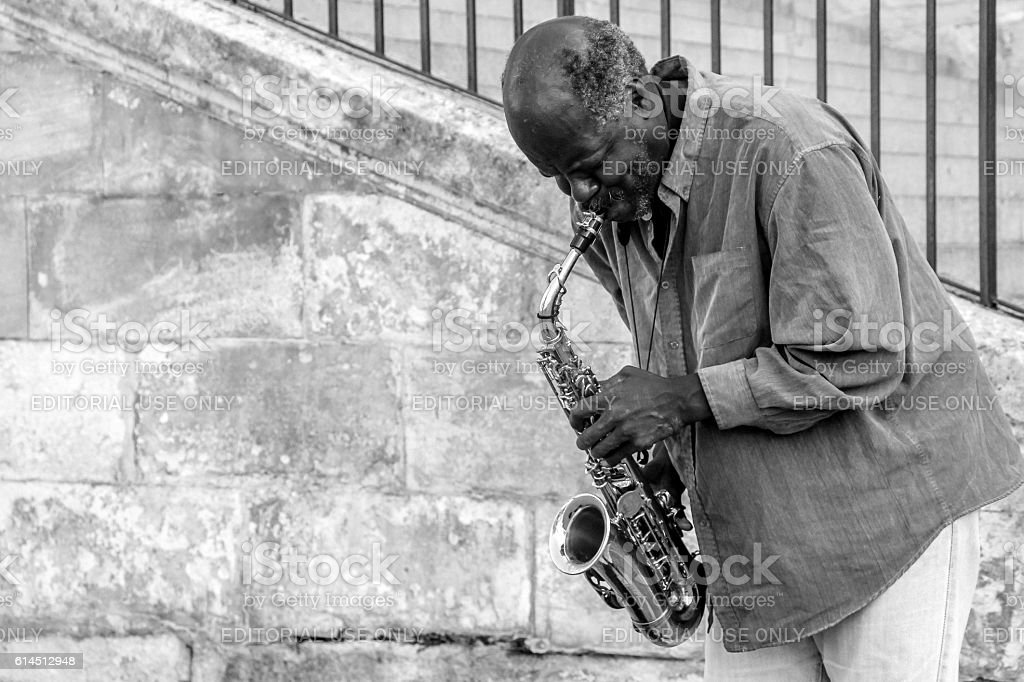 street artist play music with Saxophone stock photo