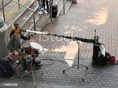 Sgtreet artist playing drums and didgeridoo in Hong Kong.