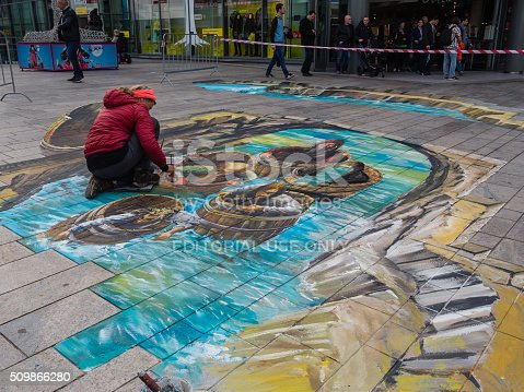 507793335 istock photo Street artist working a 3D painting 509866280