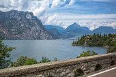 street at lake garda, Italy, blue water, wood and a small town