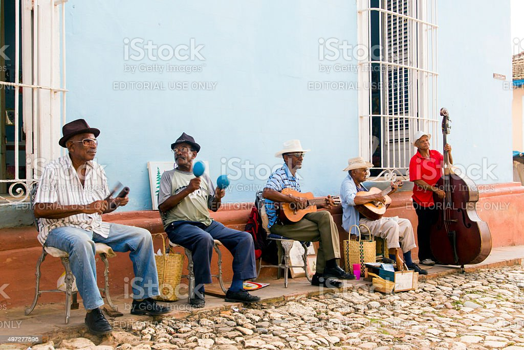Street band perform on the historic streets of Trinidad, Cuba stock photo
