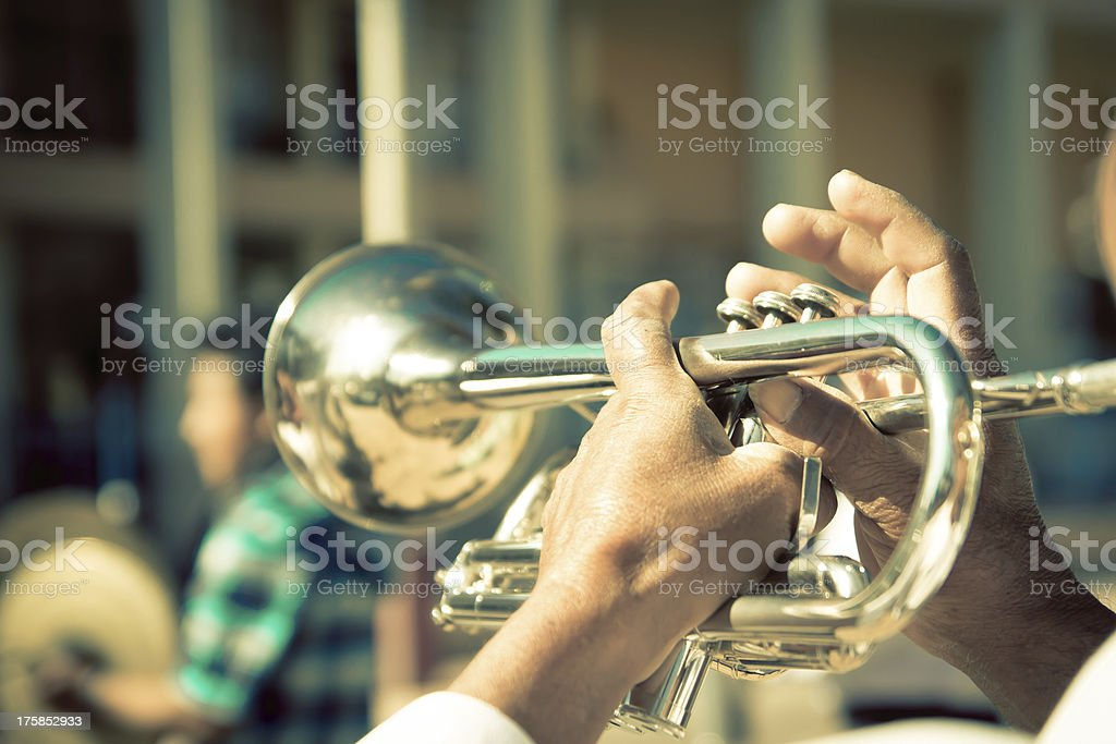 street band playing, selective focus on the hands with trumpet royalty-free stock photo