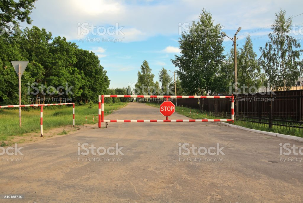 street barrier with sign 'stop' on it. Closed Road stock photo
