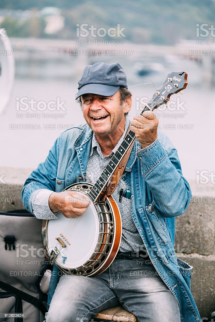Street Busker performing jazz songs at Charles Bridge in Prague stock photo
