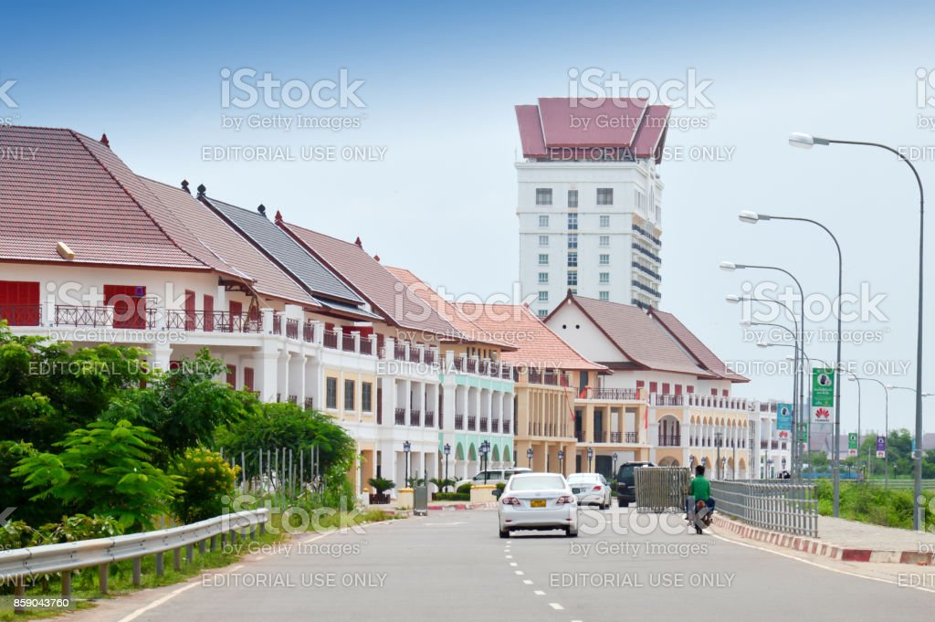 Street by the Mekong River in front of Vientiane New World (VNW), a mega project of contemporary city complex in Vientiane, capital city of Lao PDR. stock photo