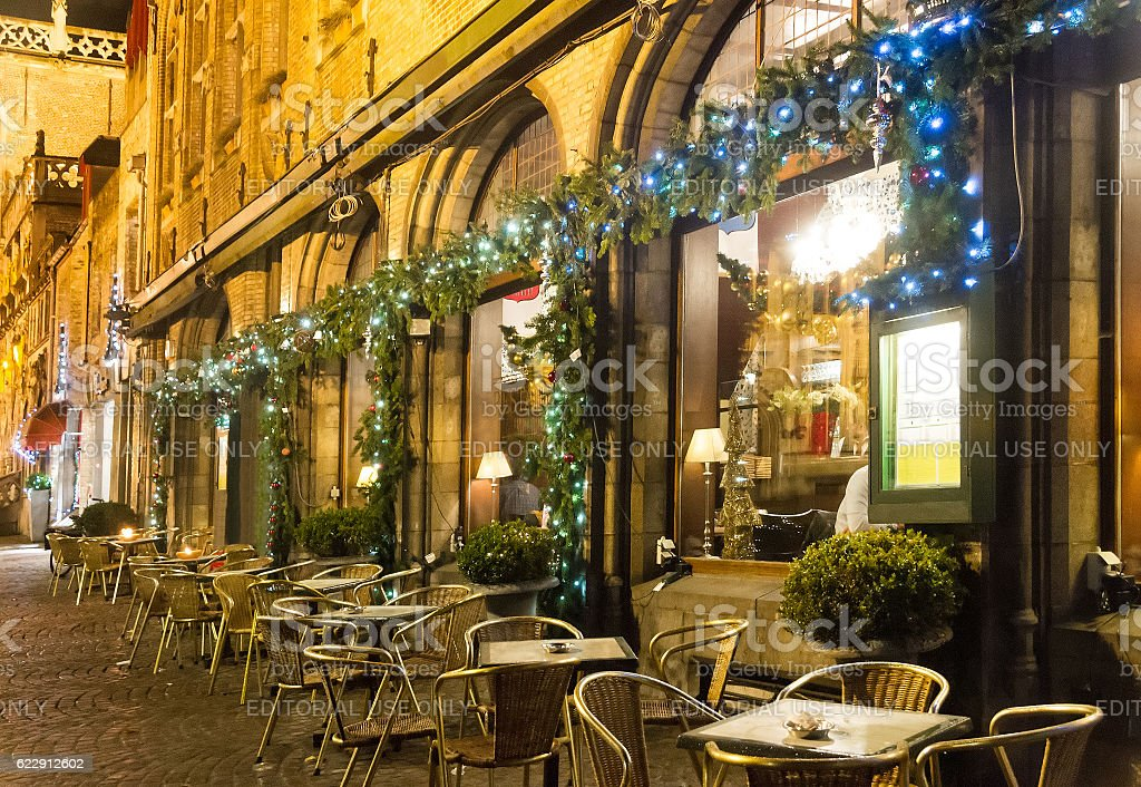 Street cafe by night decorated for Christmas - Photo