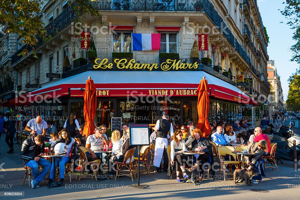street cafe in Paris, France Paris, France - October 16, 2016: street cafe in Paris with unidentified people. Paris is the capital of France and one of Europes major centres of finance, commerce, fashion, science, and the arts Blue Stock Photo