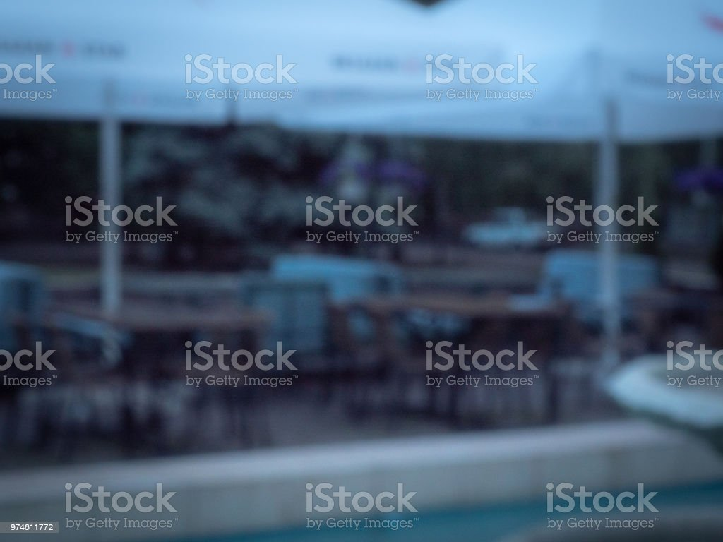 Street cafe under white canopy, blurred background. Outdoor...