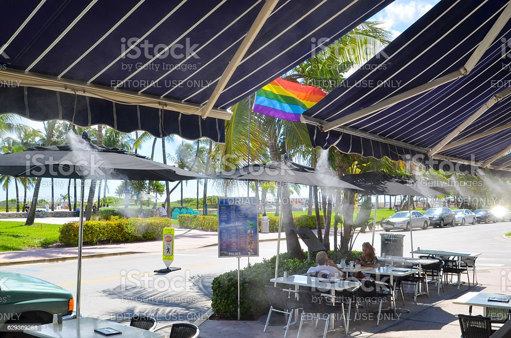 Street cafe with cool water misters, Miami stock photo