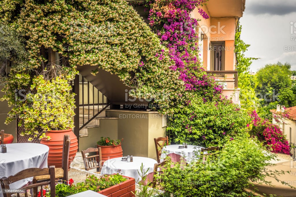 Street cafe with flowers and plants in Plaka district, Athens, Greece stock photo